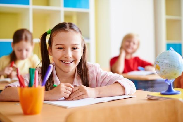 girl-with-big-smile-classroom_1098-303.jpg